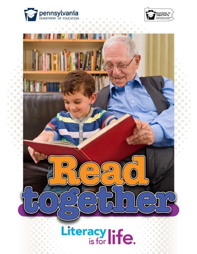poster of older male reading book to young child - read together