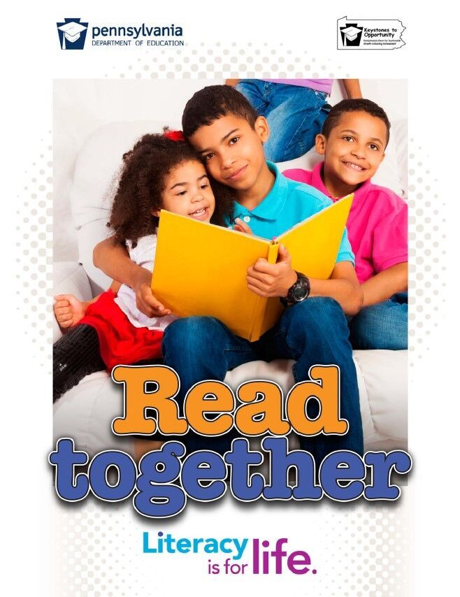poster of older boy reading to younger girl - read together