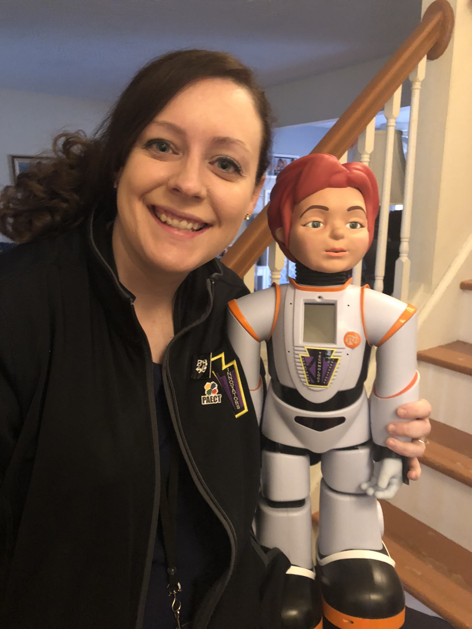 Dr. Redcay posing with the femaile humanoid named Robon.