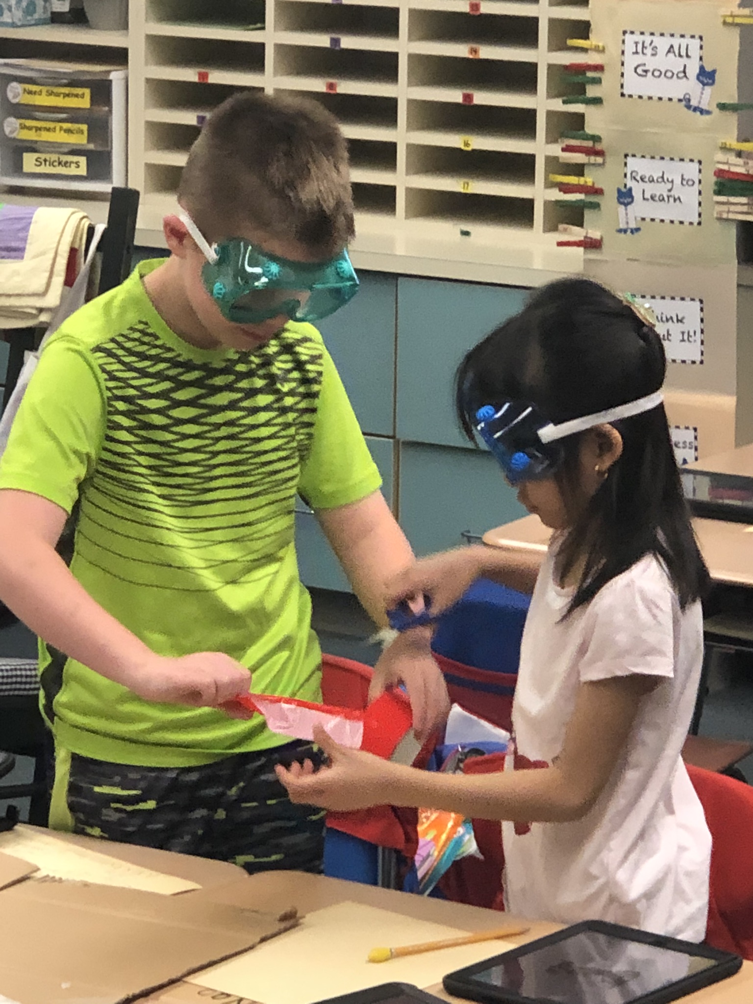 A young male and female student working together on a STEM project.