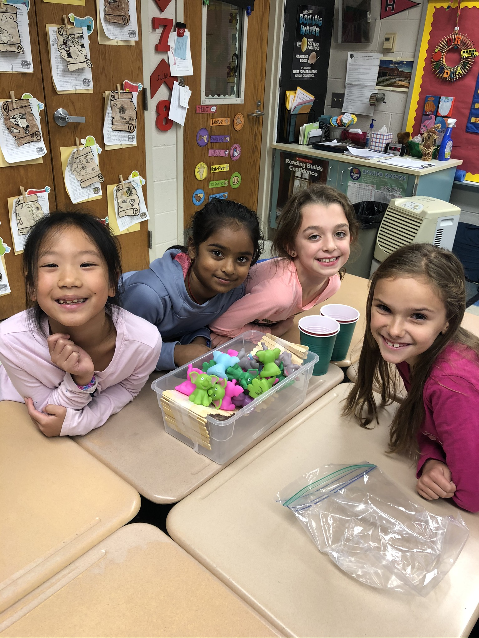 A diverse group of female students posing with a STEM project.